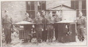 Group of 7 men from Malvern Home Guard, on exercise at Madresfield Court.