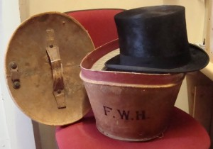 Hat box and top hat belonging to William Frederick Hayes. His initials are printed on the box